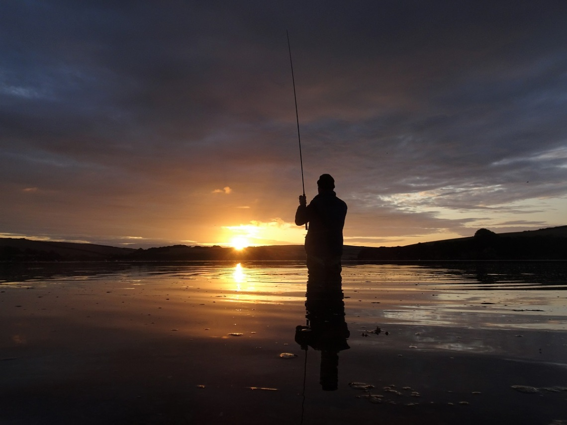 bass lure fishing at dawn