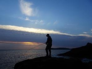 Bass lure fishing at dawn